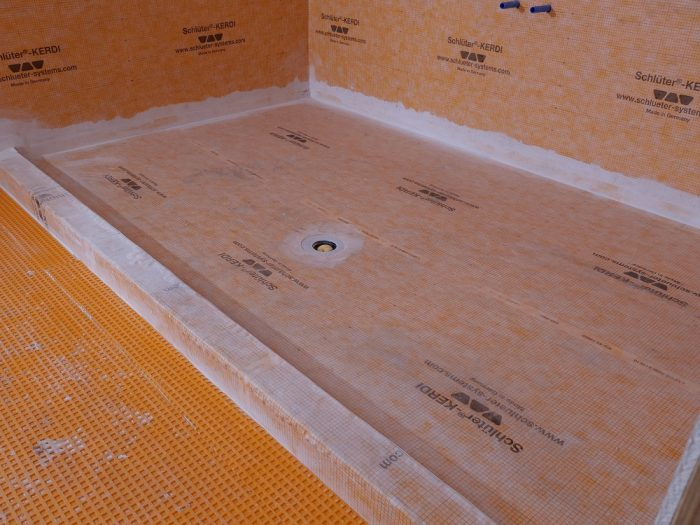 The wide Kerdi roll allows the shower base to be waterproofed with a single piece.