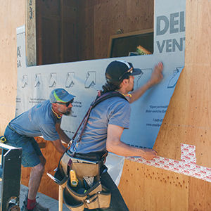 installing a water-resistive barrier
