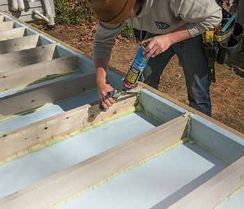 thick rigid foam in each joist bay and along the rim joists, and sealed the perimeter of the strips with spray foam
