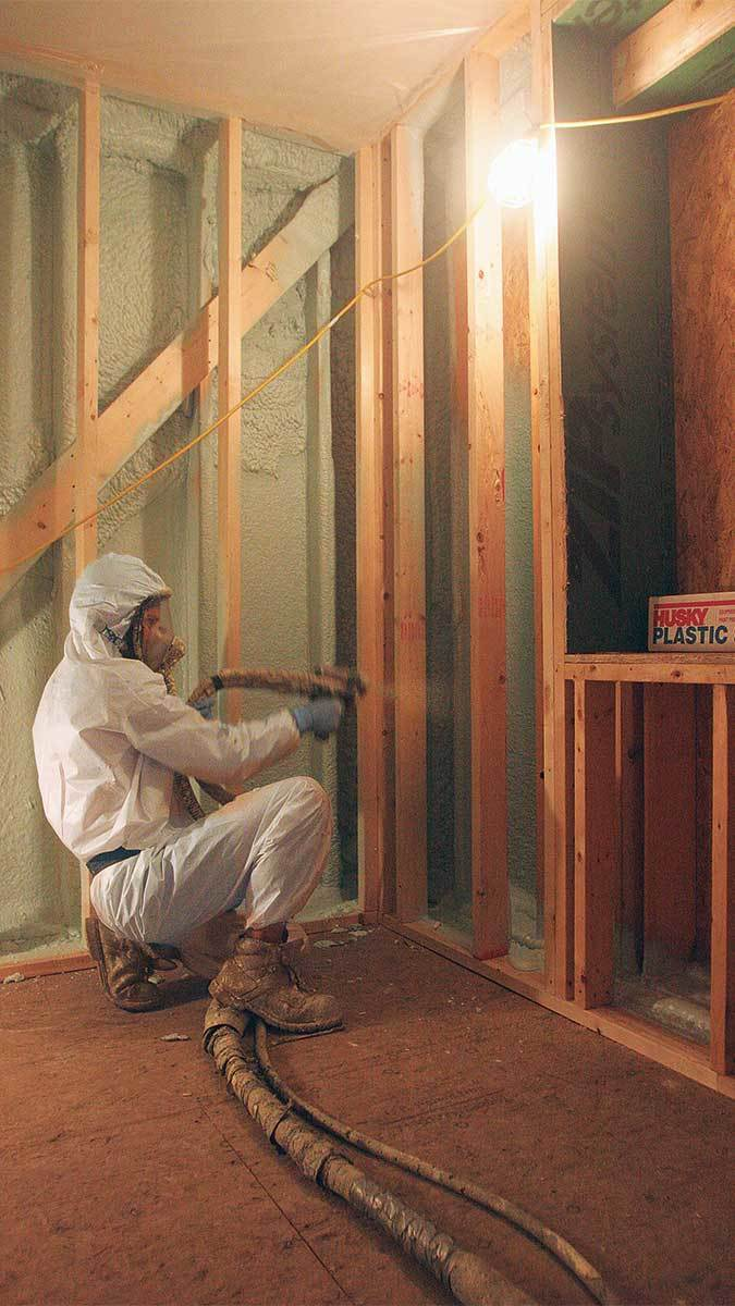 Person installing Insulation Spray