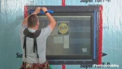 Install and flash a window in a wall with rigid foam sheathing