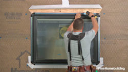 Install and flash a window over housewrap