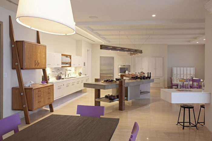 soft geometry wth square cabinets and a curved island