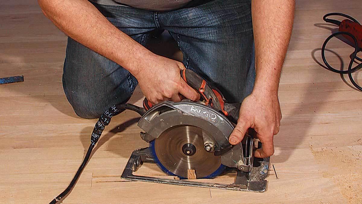 """Make three cuts. With a circular saw set to 3⁄4 in., make two cuts down the length of the board and one at an angle across (an """"N"""" shape)."""