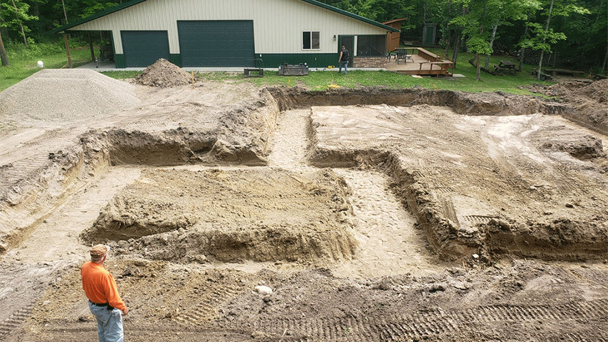 Person stands where the foundation of a house will be