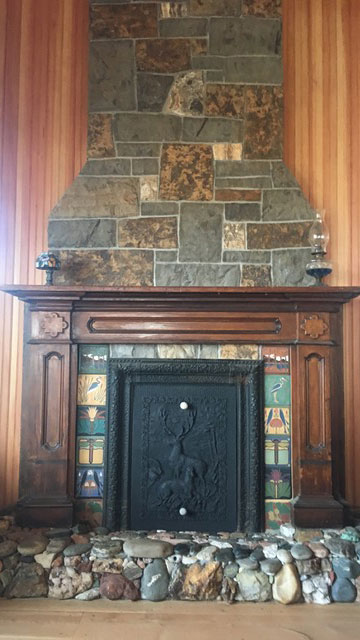 The fireplace features a threshold made of stones the client and her daughters had been collecting during their travels for years.
