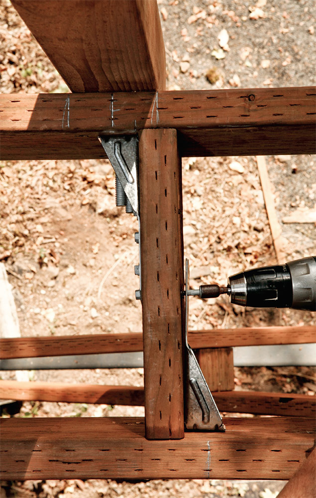 The tensioner hardware transfers any load applied to the post to the joist and decking assembly.
