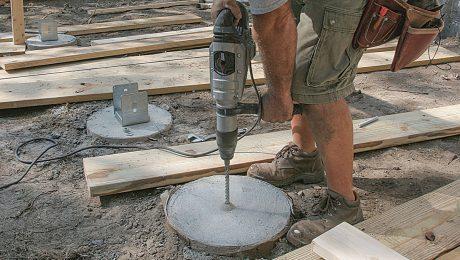 Man drilling deck footing