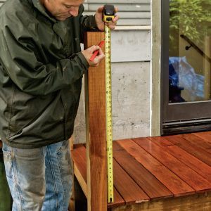 1. Measure up from the finished deck to the underside of the railing cap.
