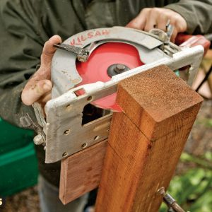 5. Use the block to guide the saw. After the first cut, reposition the block on the opposite face to finish the cut.