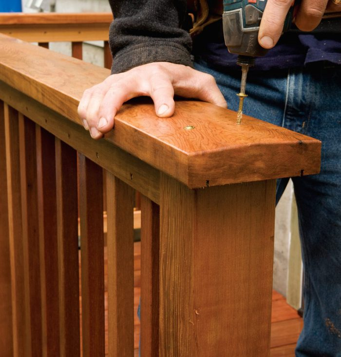 7. Overhang the post with the cap by several inches where you will add a stair railing.