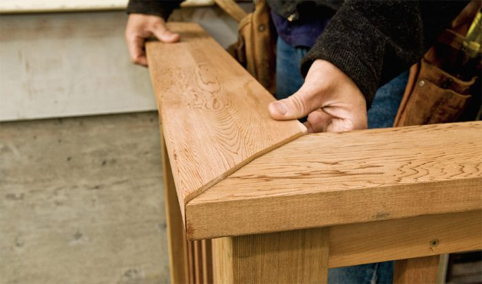 5. Fit the miter, paying close attention to the overhang along the cap's length.