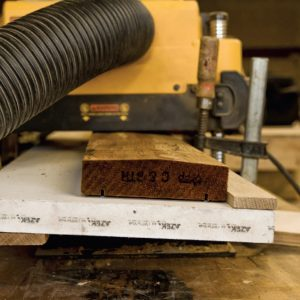 If you have a typical bench planer, a simple jig lets you make a custom railing cap out of standard 2x decking stock