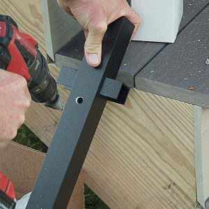 drilling holes into the post