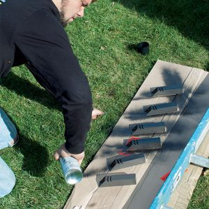 person spray painting the posts