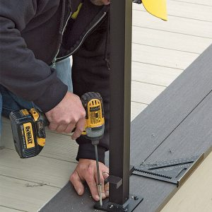 person installing the post on the deck