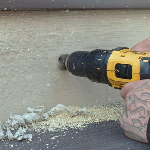 person drilling a hole