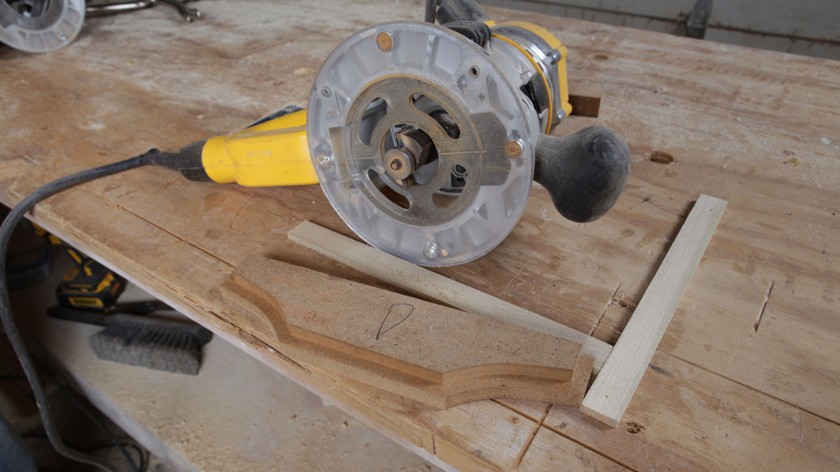 router sitting next to stepped corbel jig