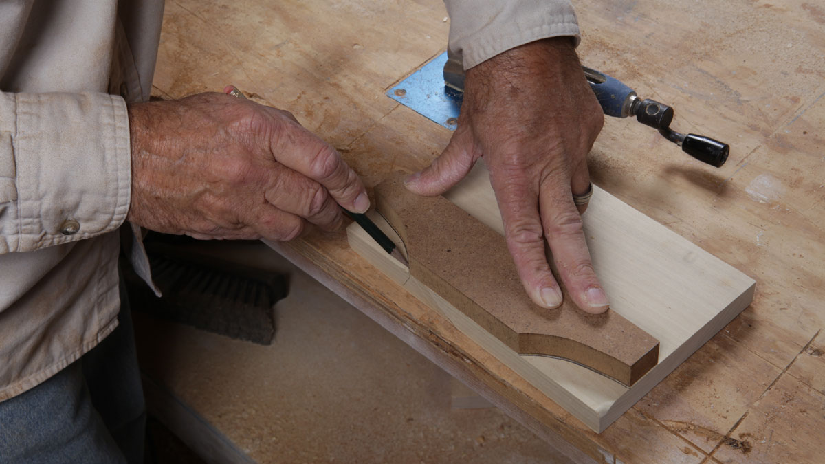 trace shape of router jig onto wood to make corbel