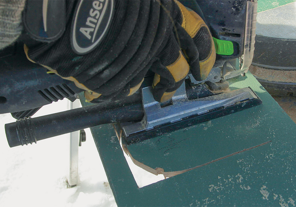 cutting a piece of siding