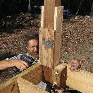 Add 4x4 blocking. Bolting into a block rather than just into the post places the bolts farther back along the joist. This reduces the chance that levering on the post will make the bolts split the end of the joist and cause a railing failure. Fasten 4x4 blocks