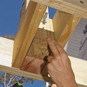 Back up the post with a 4x4 block. Cut to the height of the joists and positioned between the 2x blocks behind the post, the block is secured to the end joist and post with ThruLoks.