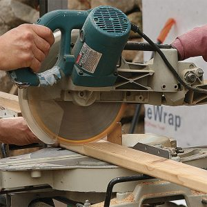 Cutting 70 balusters calls for precision. A stop block on a miter saw helps to make repeated cuts quickly and accurately. Seal the end grain with Anchorseal (uccoatings.com), a wax-based coating that reduces water wicking and discoloration.