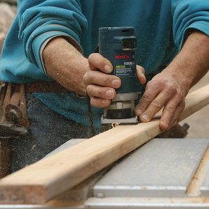 Ease the balusters' cut edges with a roundover bit in a small router.