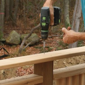 Make the cap rail from straight decking boards. Because the tops of the posts are pitched slightly, the cap rail slopes outward to shed water. Screw the cap rail down with stainless-steel trim-head screws.