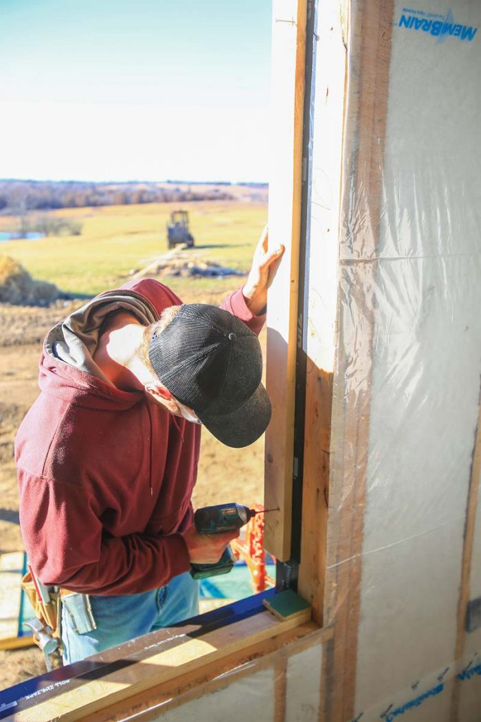 create a gap for insulation, nail small scraps of sheathing to the top of the back dam, giving the window a place to sit.
