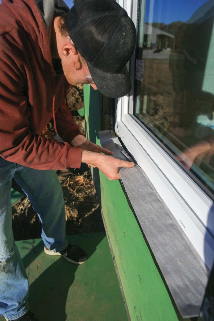 Siga Fentrim flashing tape has a thin, unbacked lip and a split backing, so you can adhere the lip to the window