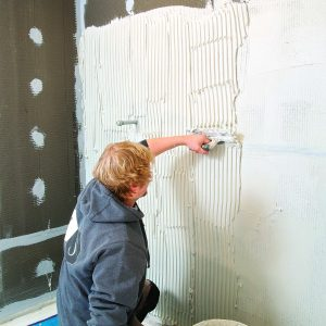 tile walls first to avoid damaging floors
