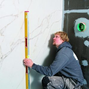 check tile slabs with level against wall