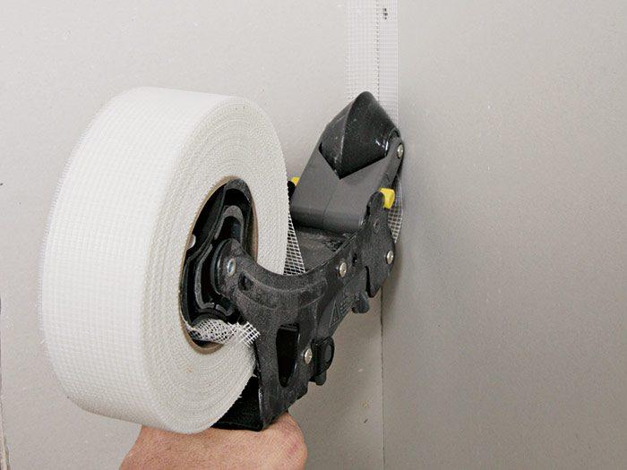 Rolling out fiberglass-mesh tape
