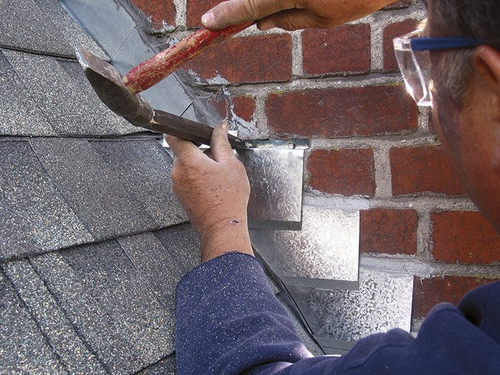 Counterflashing held in place by masonry nails.jpg