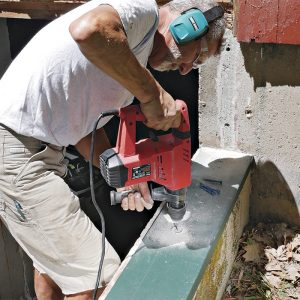 drill through the metal and into the masonry