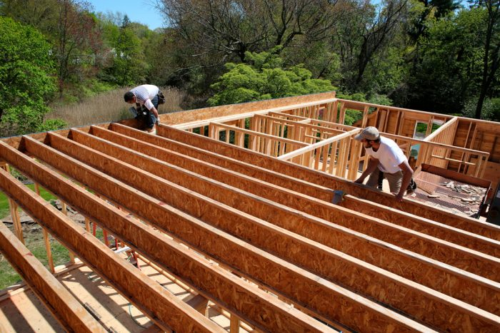 To support the heavier load, new TJI joists were installed. TJIs are stronger and lighter than dimensional lumber, but the wide 30-ft. span still requires them to bear on a center wall below.