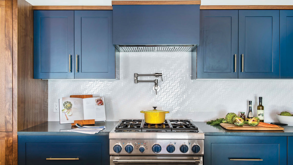 blue cabinets in a condo kitchen
