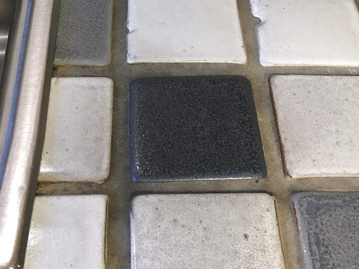 grout showing food and water stains