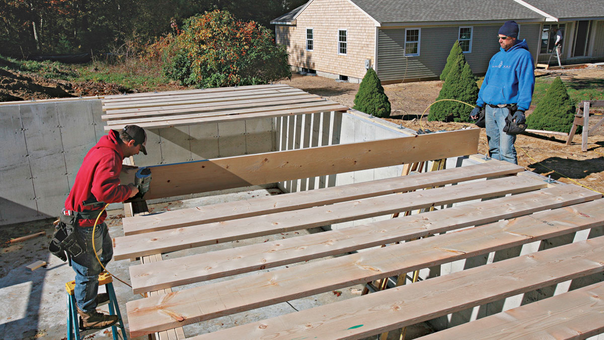The first joists nailed into place hold the beam straight and prevent it from slipping out of position as subsequent joists are installed.