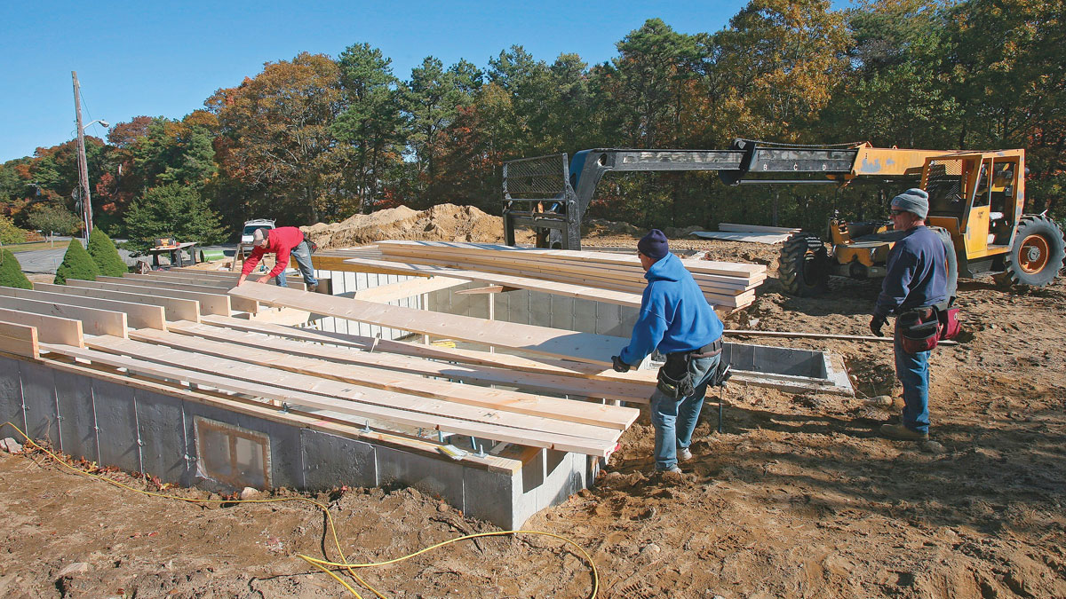 With the beam held in place by the front joists, the back joists can easily be loaded and installed.