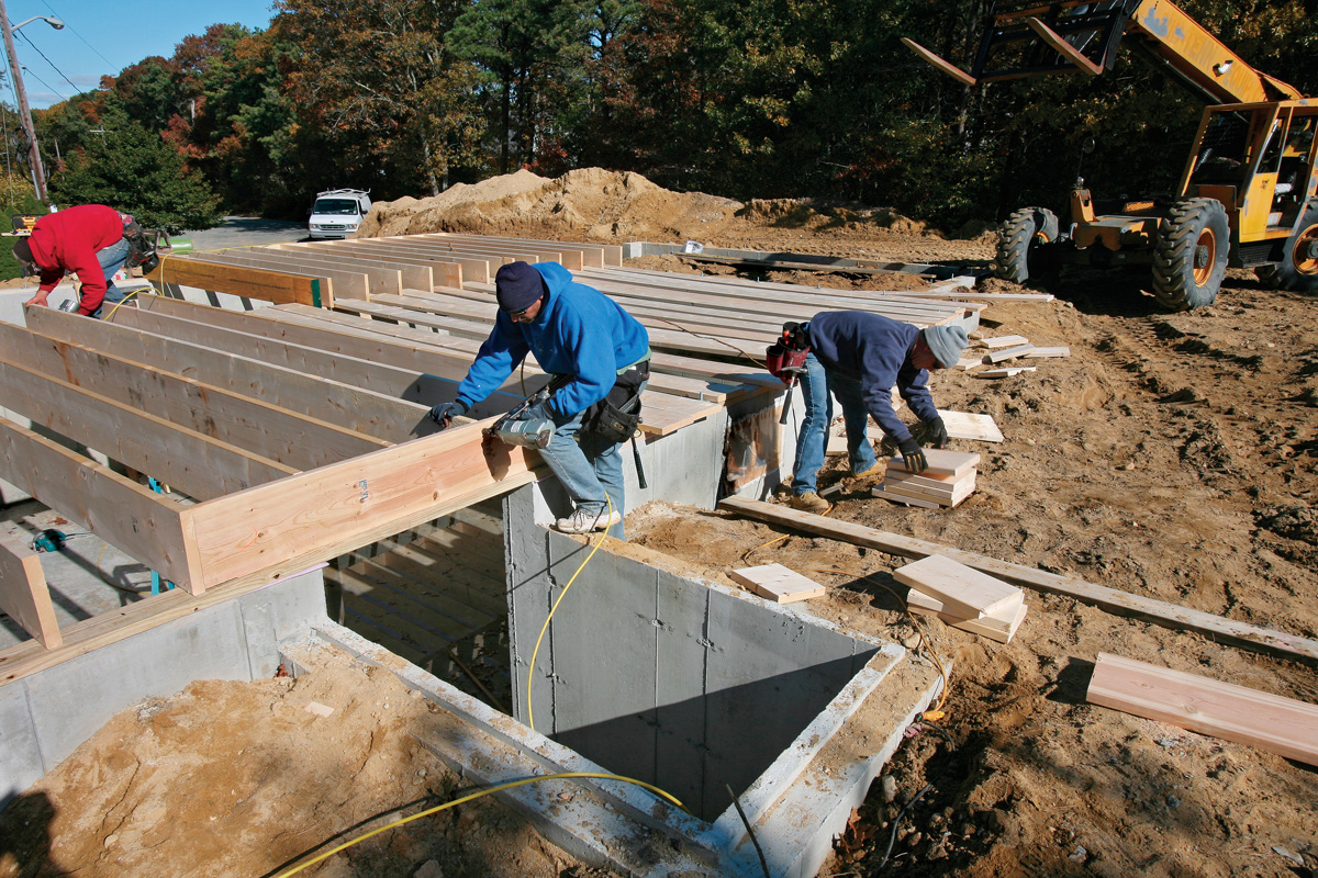 The bulkhead required a header to span the opening, so an extra layer of rim joist stock was nailed to the shortened joists. The main rim joist itself will form the second half of the header when the two pieces are nailed together.