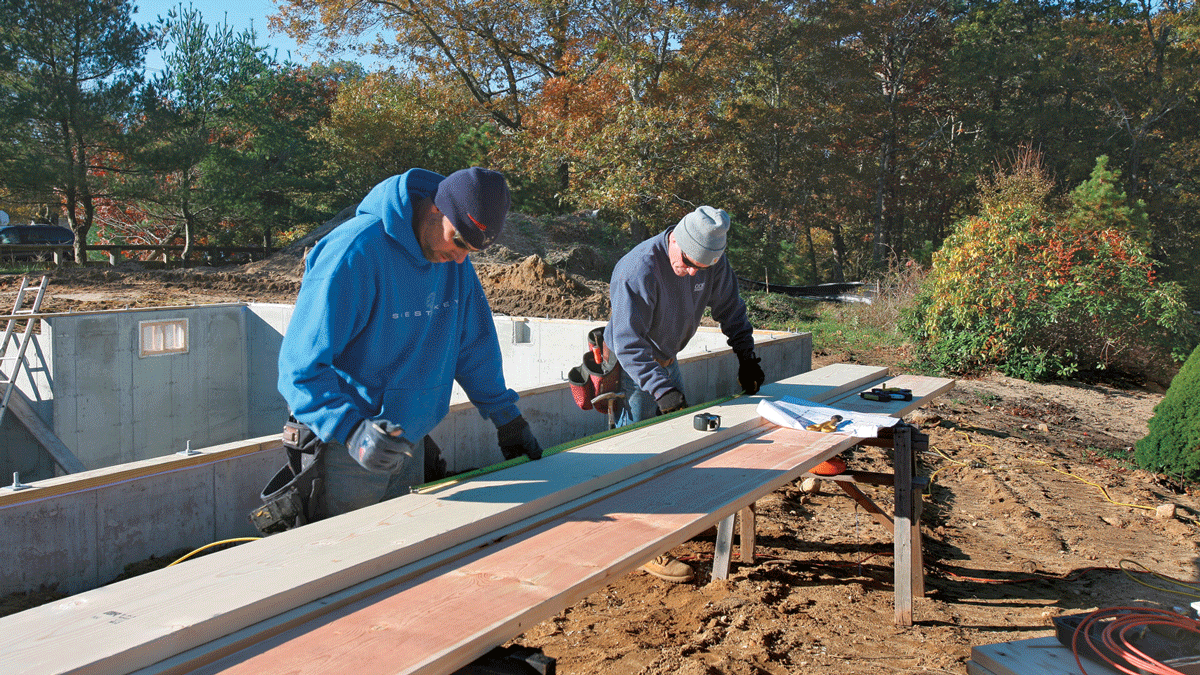 Working from the framing plan, measure and cut individual lengths of lumber for the beam so that every joint will land over a Lally column.