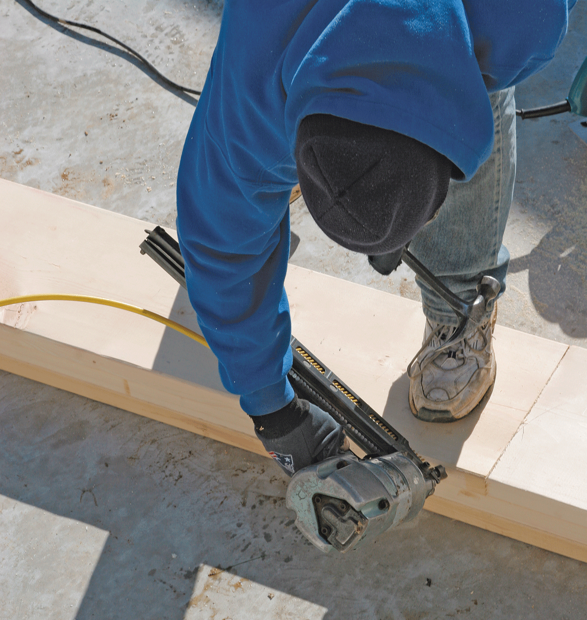 To align boards edge to edge, drive a toenail into the edge of the overhanging board, then pound the nail with a hammer until the board edges line up.