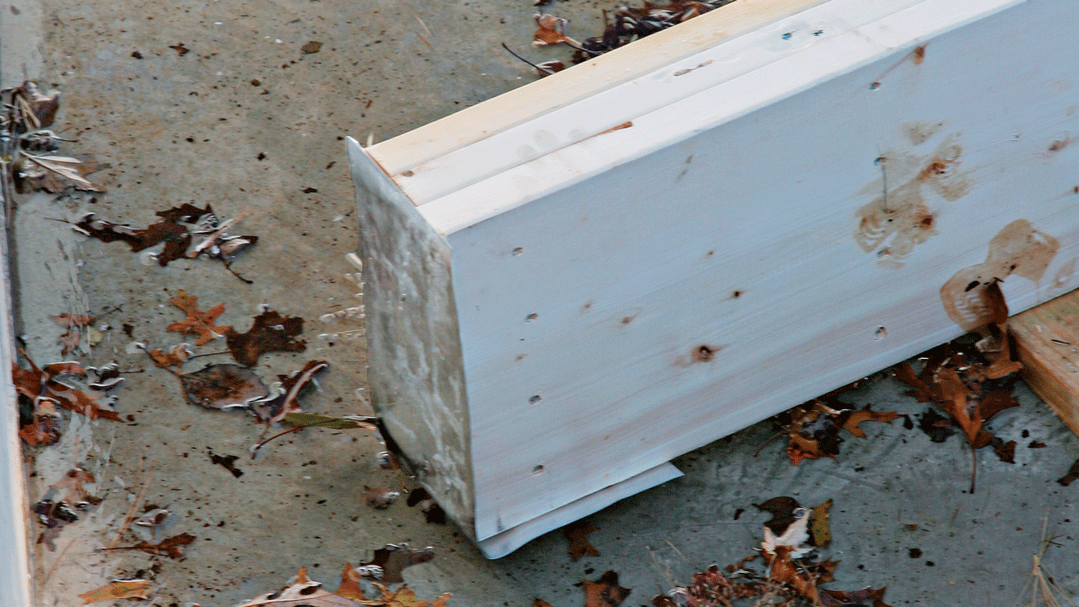 Aluminum flashing nailed to the ends of the support beam provides added protection against rot.