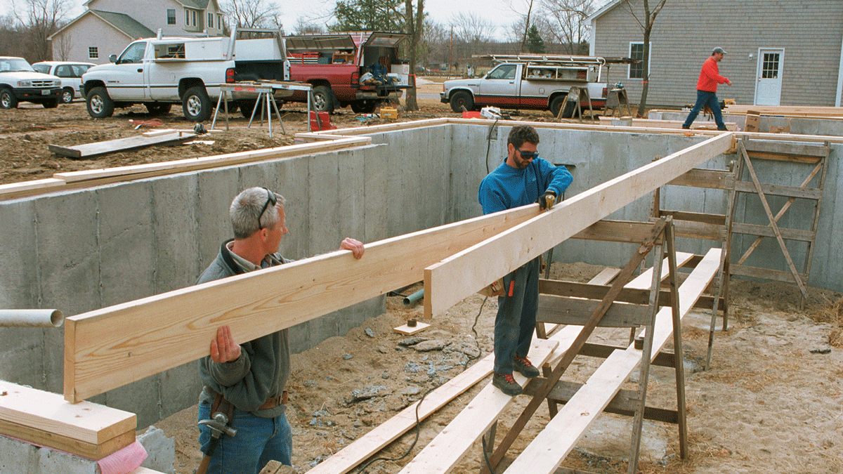 When assembling a beam in place, support it on temporary trestles as you work. Keep the pieces in order and be sure to follow the nailing schedule exactly. (Note the double mudsill on this project.)