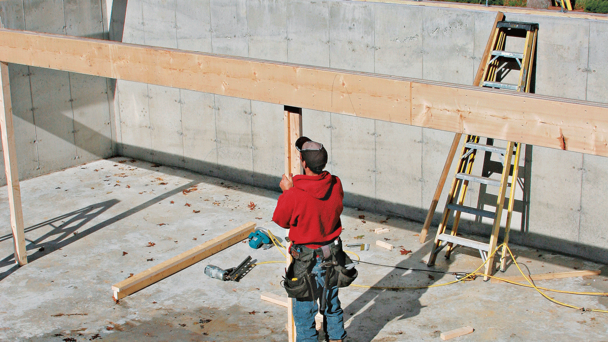 Temporary posts nailed in a T-shape can be tacked to the underside of the beam for support.