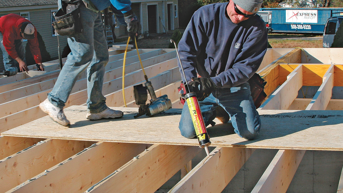 Construction adhesive prevents squeaks and stiffens the floor system. A sheet of floor sheathing provides a safe and comfortable platform from which to work.