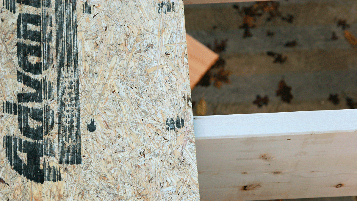 When the first sheet is in place, tack a corner to hold it at the centerline of the joist (photo 66). Then nail it to the remaining joists, guided by the layout marks printed on the sheathing (photo 67). This prevents the joists from wandering off course as subsequent sheets are installed.