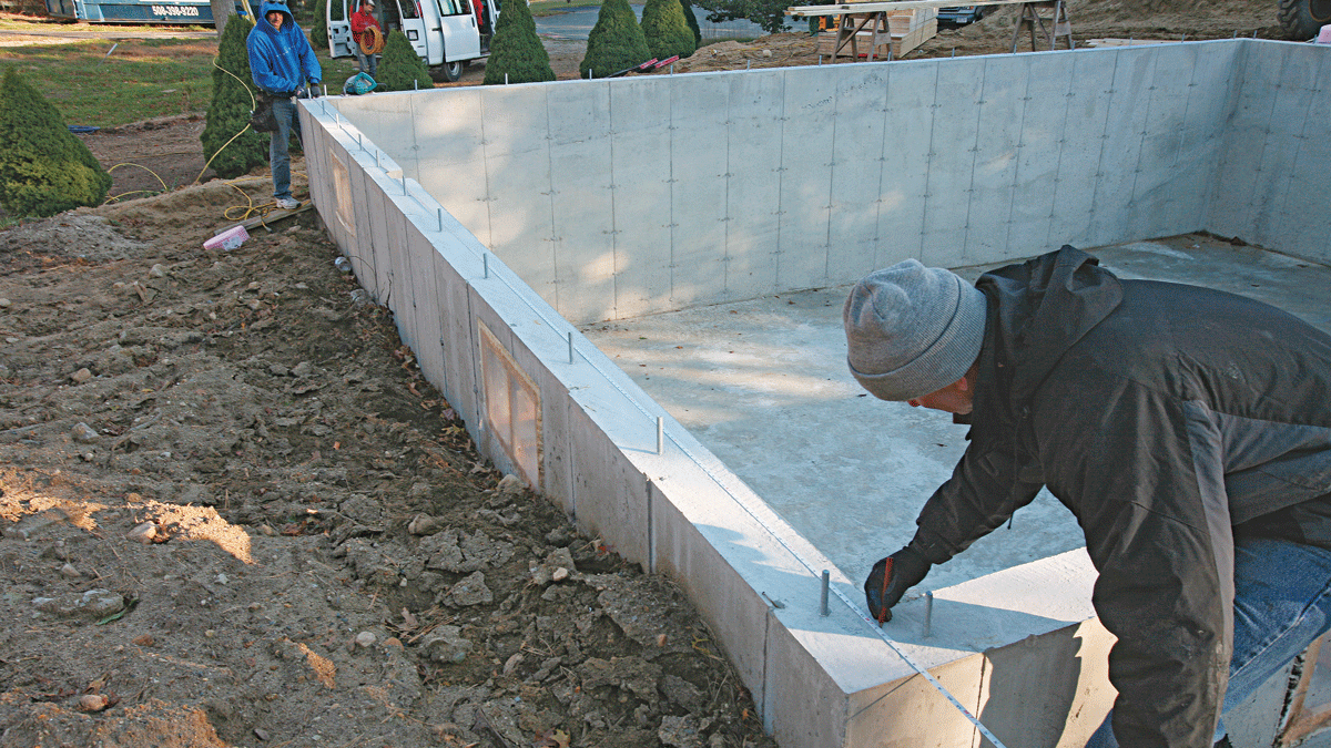 To establish a layout line for the parallel mudsill, measure and mark the same distance from the baseline at each end of the foundation, then snap a chalkline between the marks. Baseline wall Parallel wall